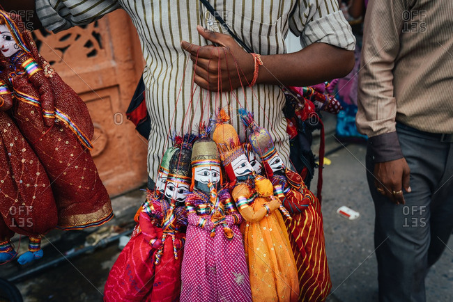 A man selling dolls on the street, Jaipur, India 2013