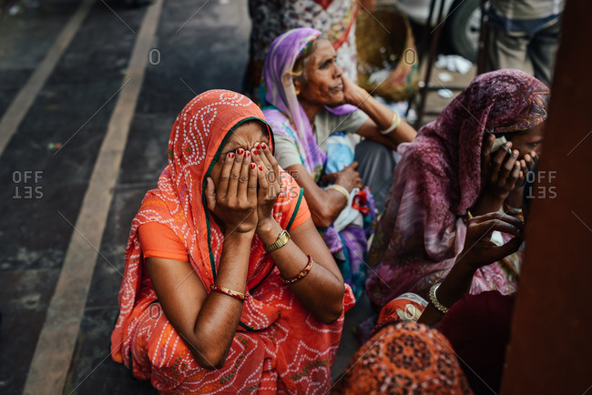 Jaipur, India - October 3, 2013: Women sitting in the street in Jaipur, India