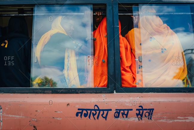Jaipur, India - October 3, 2013: Women riding on a public bus in Jaipur, India