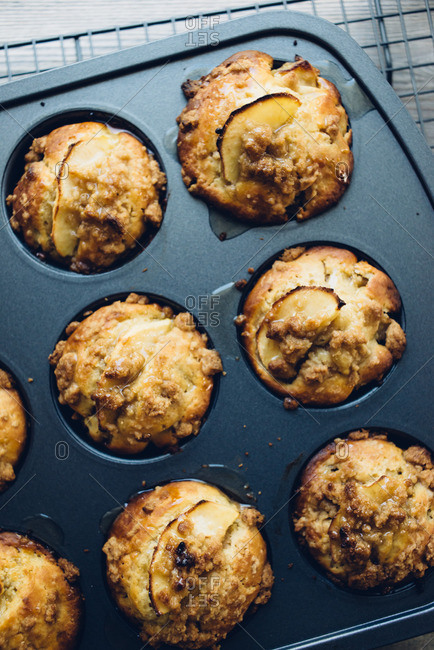 Apple muffins in a baking pan