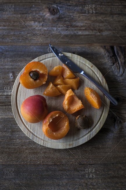 Apricots on a wooden cutting board