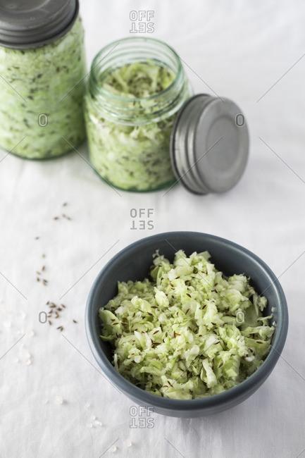 Jars and a bowl of sauerkraut