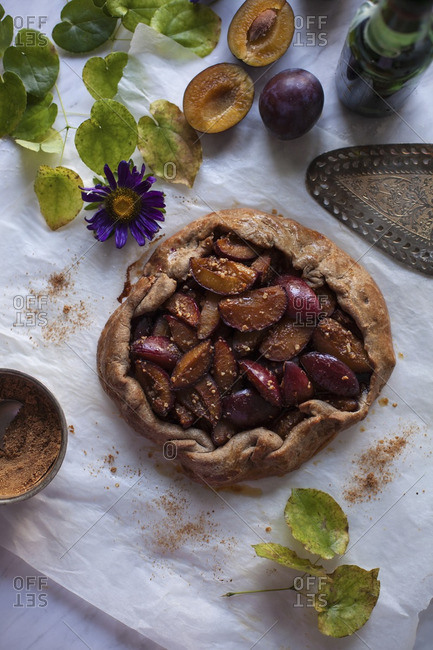 Fresh baked plum galette on a baking paper