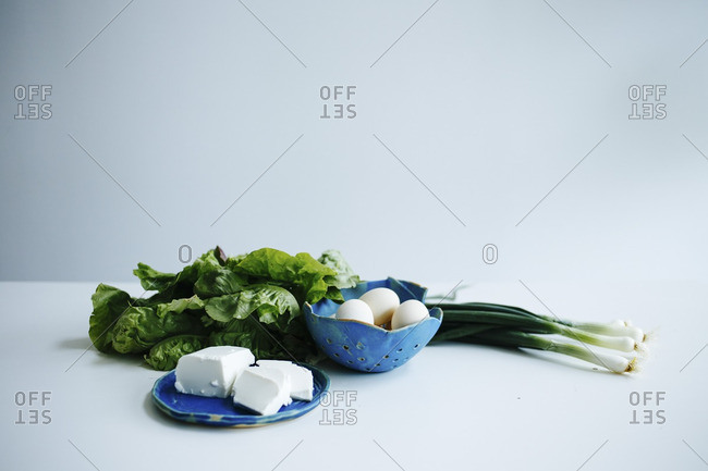 Spring produce on a white table with white background