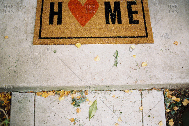 Home welcome mat on front stoop