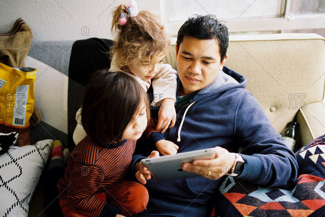 Family playing game on a tablet together