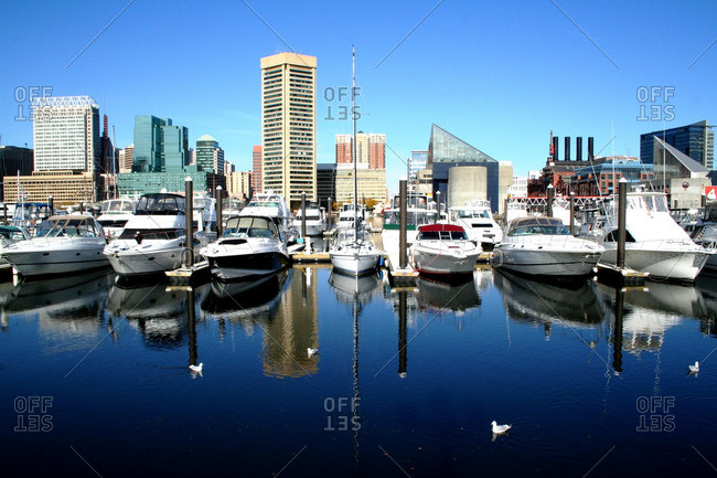 Baltimore, Maryland - November 29, 2007: Boats and buildings lining the downtown harbor in the city of Baltimore on a crisp winter day
