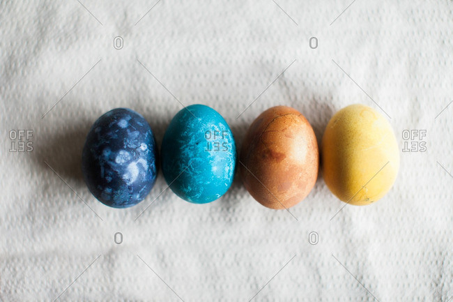 Easters eggs dyed with bright and deep colors in a row
