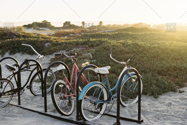 Parked bicycles on a beach