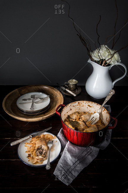 Eastern European cabbage rolls with pot and vase in background