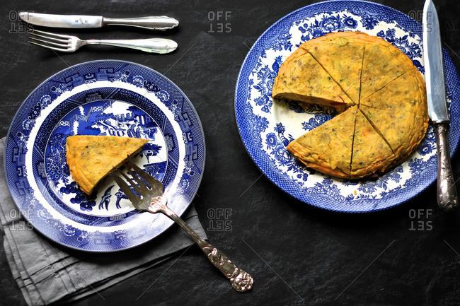 Spanish omelet on vintage blue plates