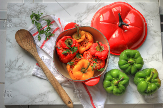 Stuffed peppers in a tomato-shaped pot