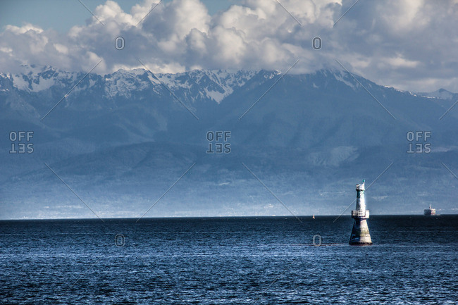 Waterscape with buoy and mountain background