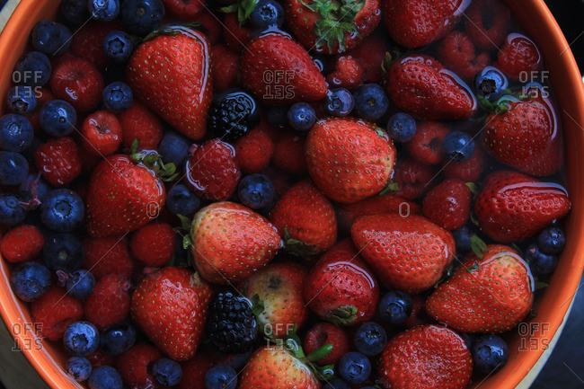 Fresh berries in a bowl of water