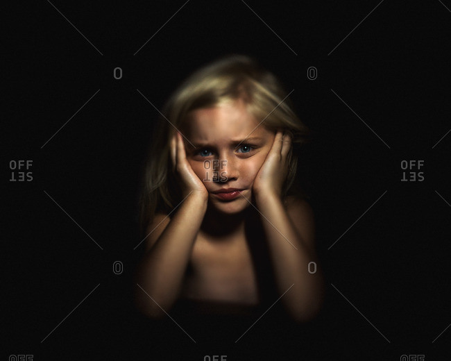 Portrait of a little girl with frustrated expression