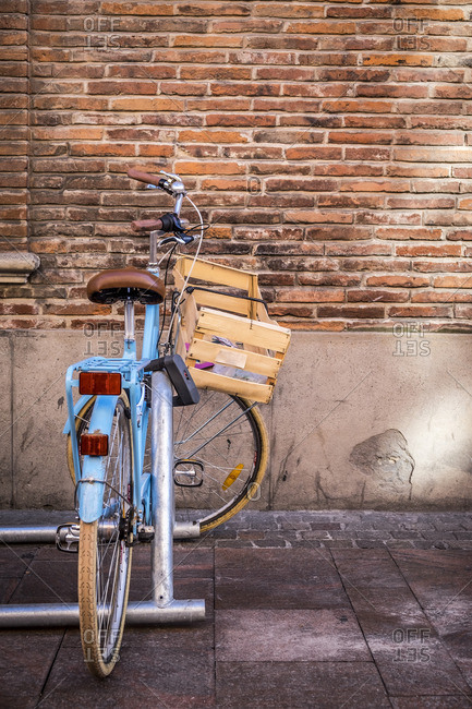 Toulouse, France - September 14, 2016: Bicycle parked in a bike stand on sidewalk