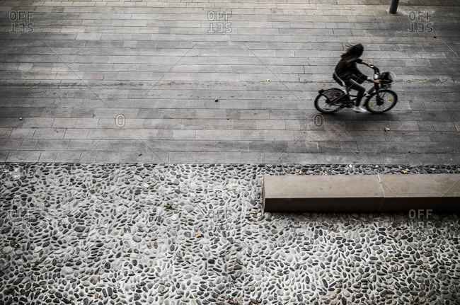 Elevated view of bicyclist in Toulouse, France