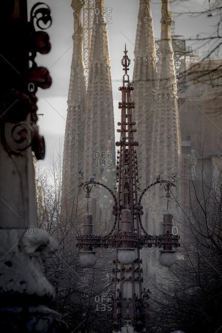 Barcelona, Spain - February 7, 2016: Ornate lampposts mimic the spires of Basilica de la Sagrada Familia