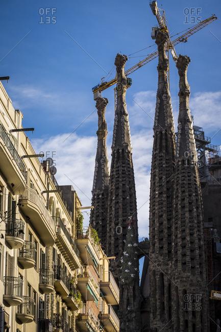 Barcelona, Spain - February 7, 2016: Apartment buildings near the Basilica de la Sagrada Familia