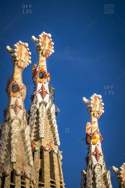 Barcelona, Spain - February 7, 2016: Spires decorated with mosaic on Gaudi's Basilica de la Sagrada Familia