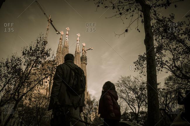 Barcelona, Spain - February 7, 2016: Man and child gazing at Basilica de la Sagrada Familia