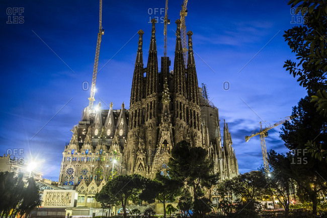 Barcelona, Spain - February 7, 2016: Sagrada Familia under restoration at dusk