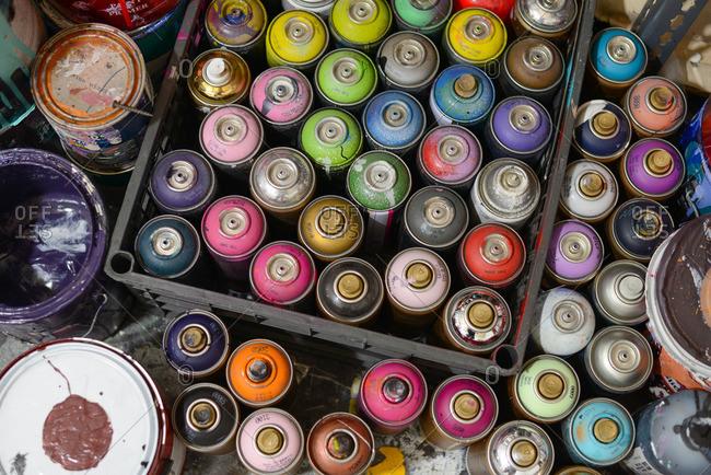 Spray paint cans on floor