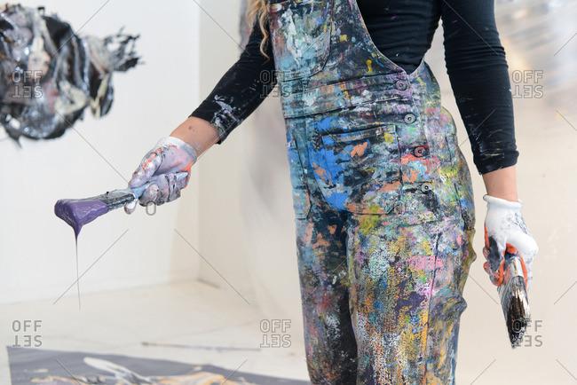 Paint artist working in her studio