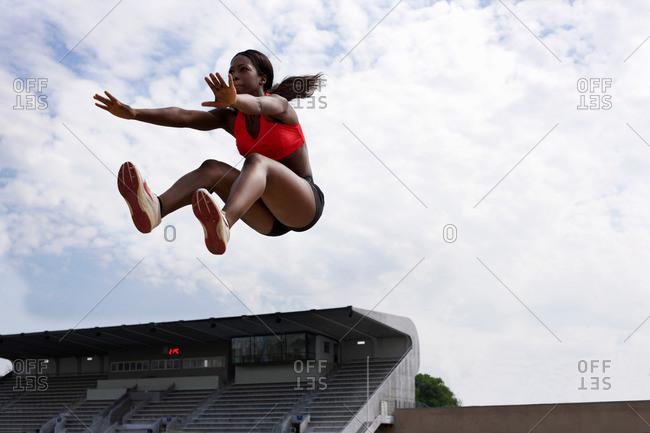 Athlete in midair during long jump