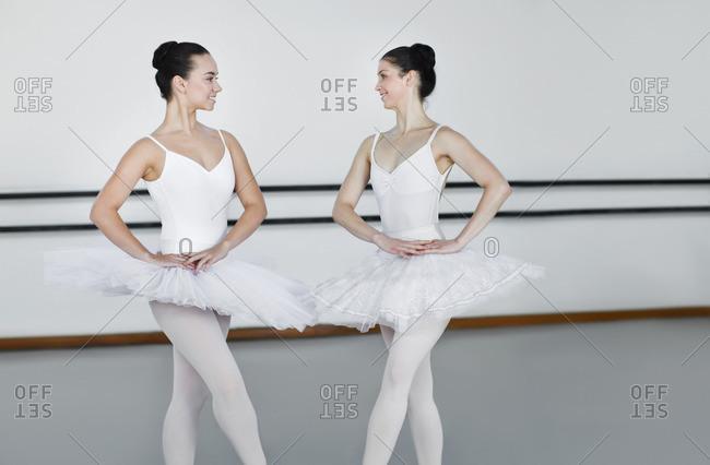 Ballet dancers posing together in studio