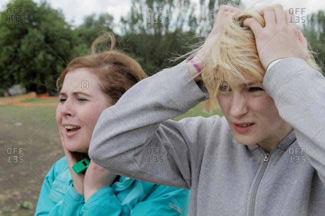 Anxious girls watching a match outdoors