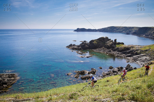 Mountain bikers riding on coastline