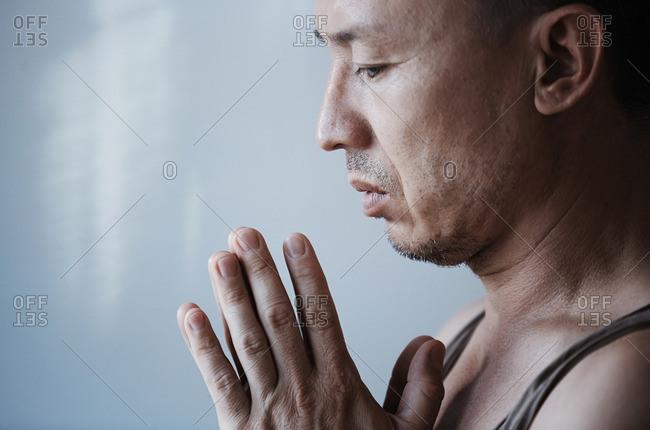 Man meditating during yoga