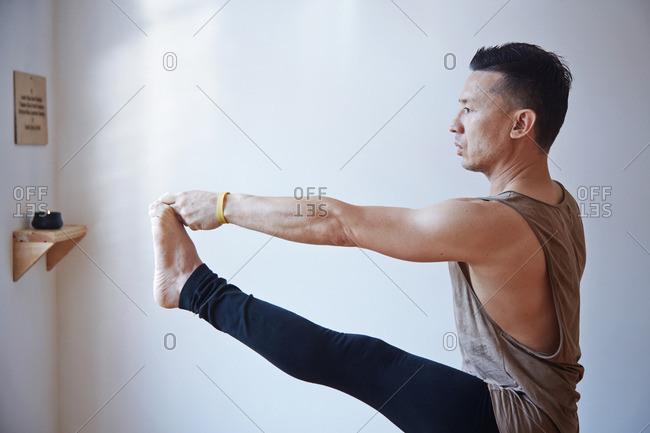 Man practicing yoga balance