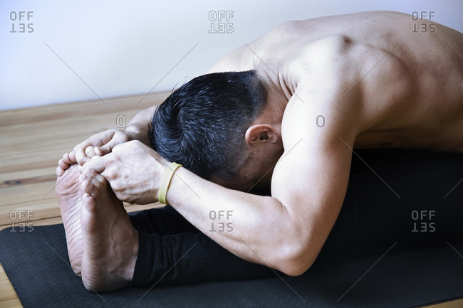Man in yoga fold position
