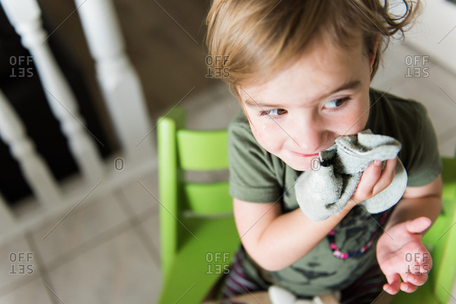 Child wiping face with washcloth