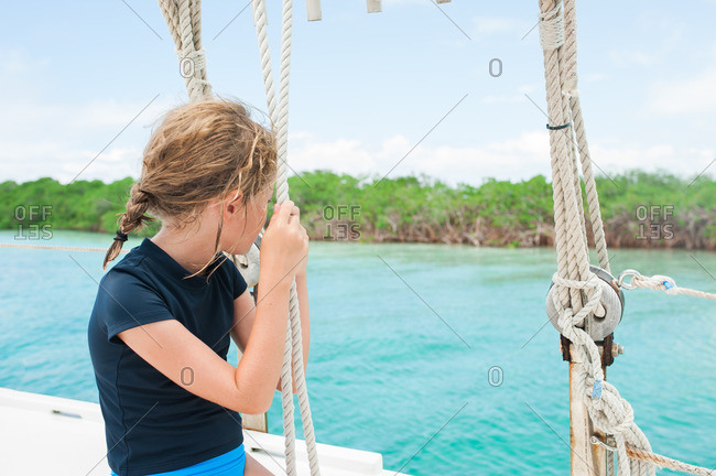 Girl staring off on sailboat