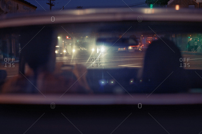 November 1, 2010: Couple in car backlit by headlights