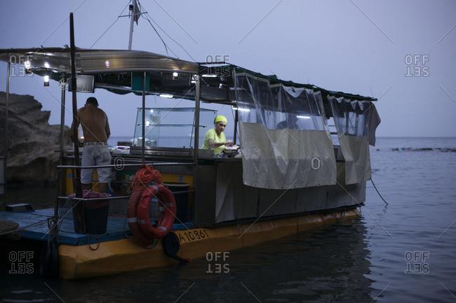 Naples, Italy - July 9, 2015: A boat restaurant at shore