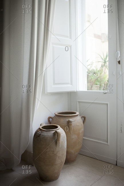 Urns by a window