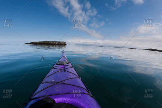 Nose of kayak on still lake
