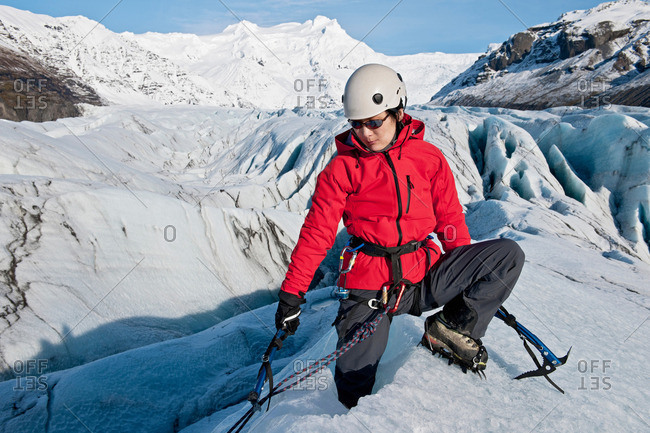 Climber holding rope on glacier