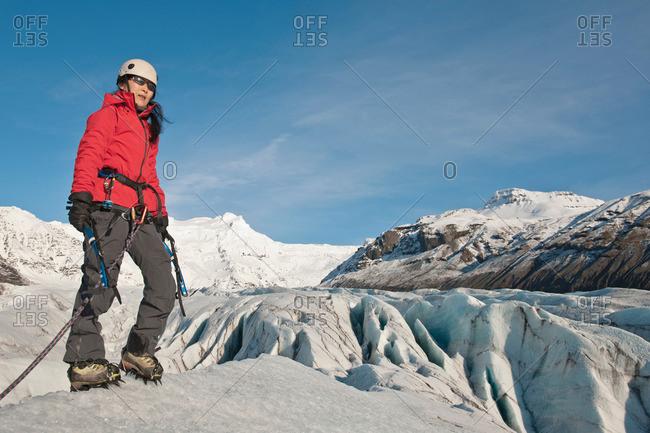 Climber walking on glacier