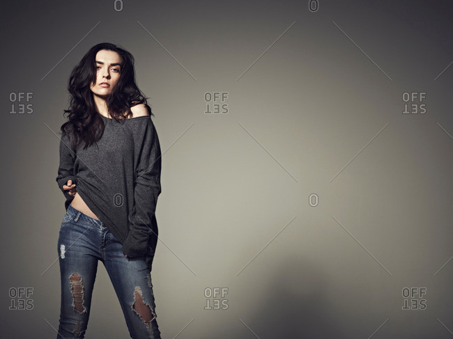 Woman playing with baggy sweatshirt