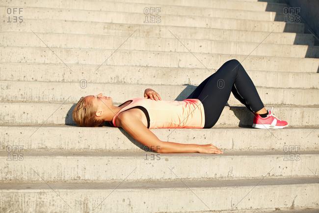 Runner resting on staircase
