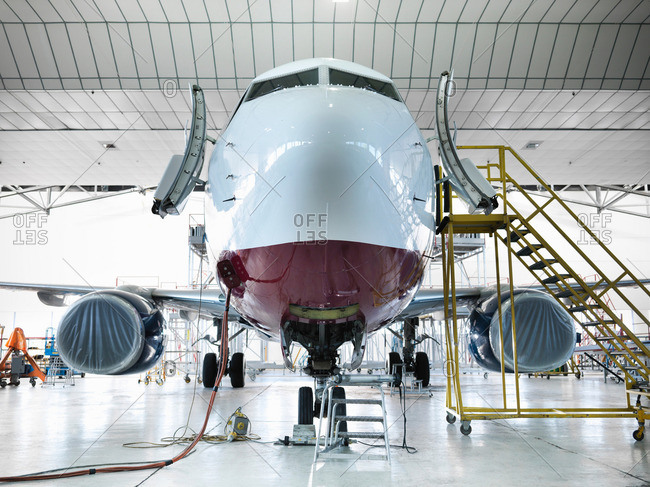 Front view of a jet aircraft in hangar