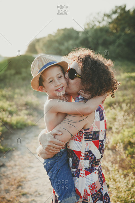 Mother and son hugging on a nature trail