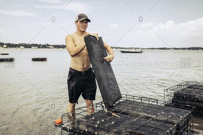 Man on an oyster farm