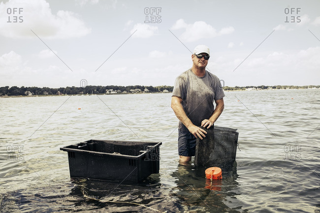 A man working at oyster farm