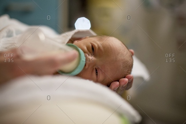 Premature baby fed from a bottle